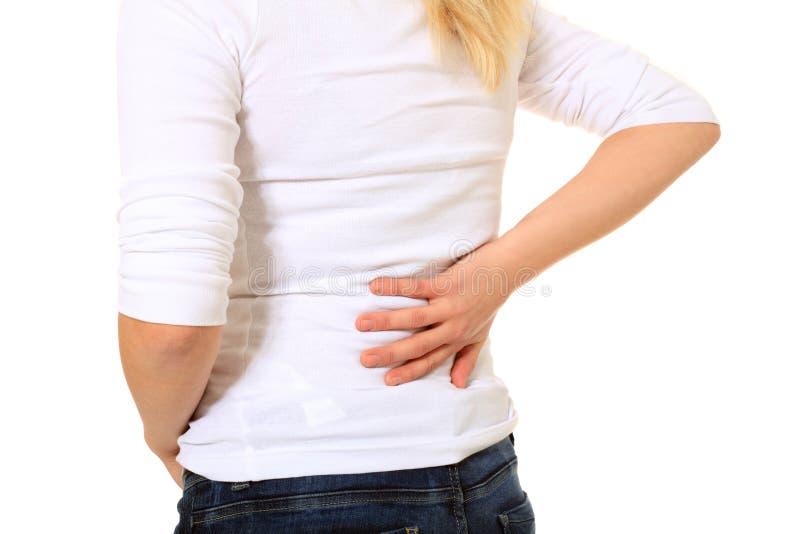 A pessoa fêmea sofre da dor lombar imagem de stock