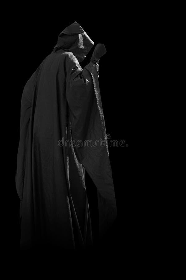 Pessoa no casaco preto imagem de stock