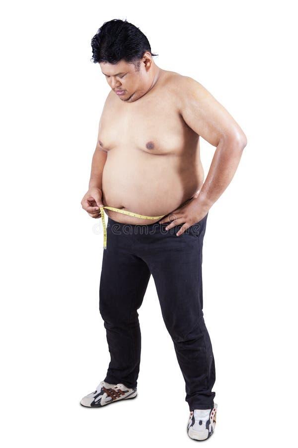Pessoa obeso que mede o seu barriga 3 imagens de stock royalty free