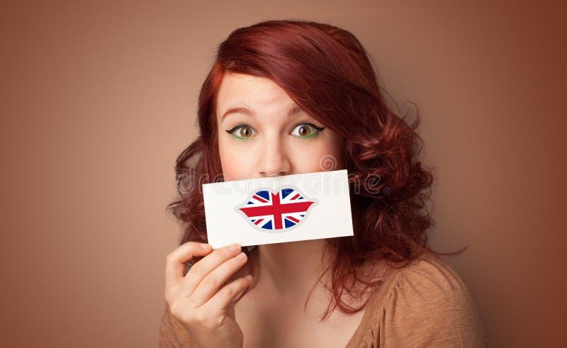 Pessoa que guarda o cart?o da bandeira do Reino Unido fotografia de stock
