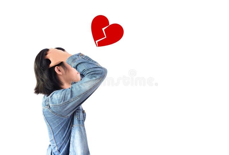 A pessoa que perde o coração, guarda a cabeça com ambas as mãos a foto de stock