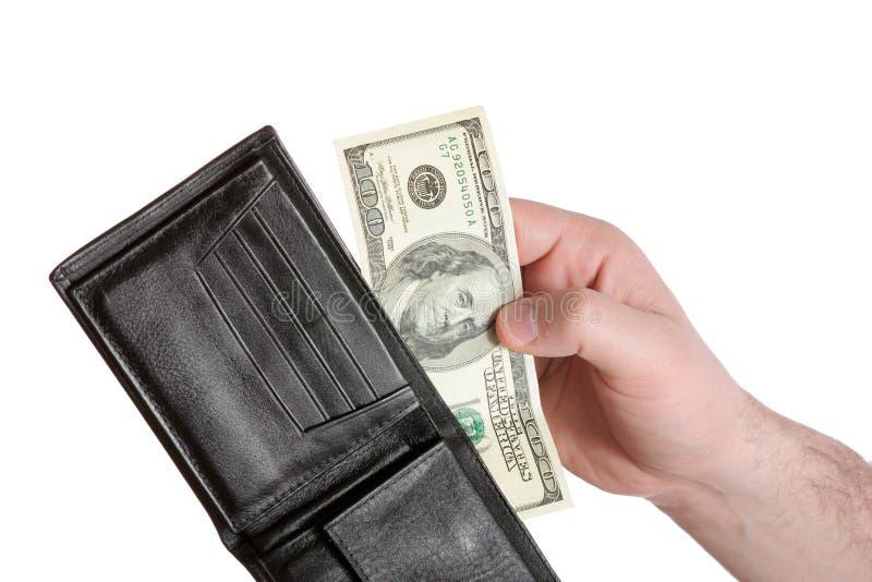 Pessoa que remove uma conta de dólar 100 fora de seu walet imagem de stock royalty free