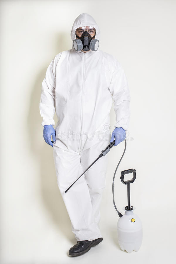 Pest Control, Bio Hazard Worker. Pest control worker with a pesticide sprayer, dressed in bio hazard coveralls and gear royalty free stock images
