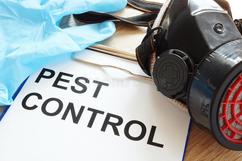 Pest control. Clipboard, respirator and gloves. Pest control concept. Clipboard, respirator and gloves stock photography