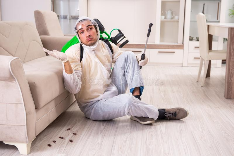 Pest control contractor working in the flat stock photography