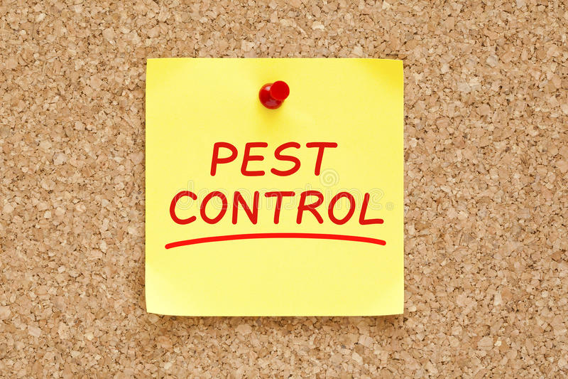 Pest Control Sticky Note. Pest Control on yellow sticky note pinned with red push pin on cork board stock images