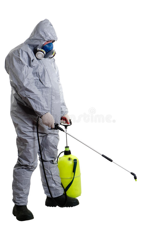 Pest Control Worker. A pest control worker wearing a mask, hood, protective suit and dual air filters holding a hose to help exterminate rats and other vermin stock images