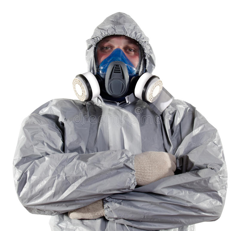 Pest Control Worker. A pest control worker wearing a mask, hood, protective suit and dual air filters holding a hose to help exterminate rats and other vermin royalty free stock photos