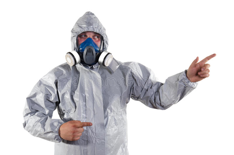 Pest Control Worker. A pest control worker wearing a mask, hood, protective suit and dual air filters holding a hose to help exterminate rats and other vermin stock photography