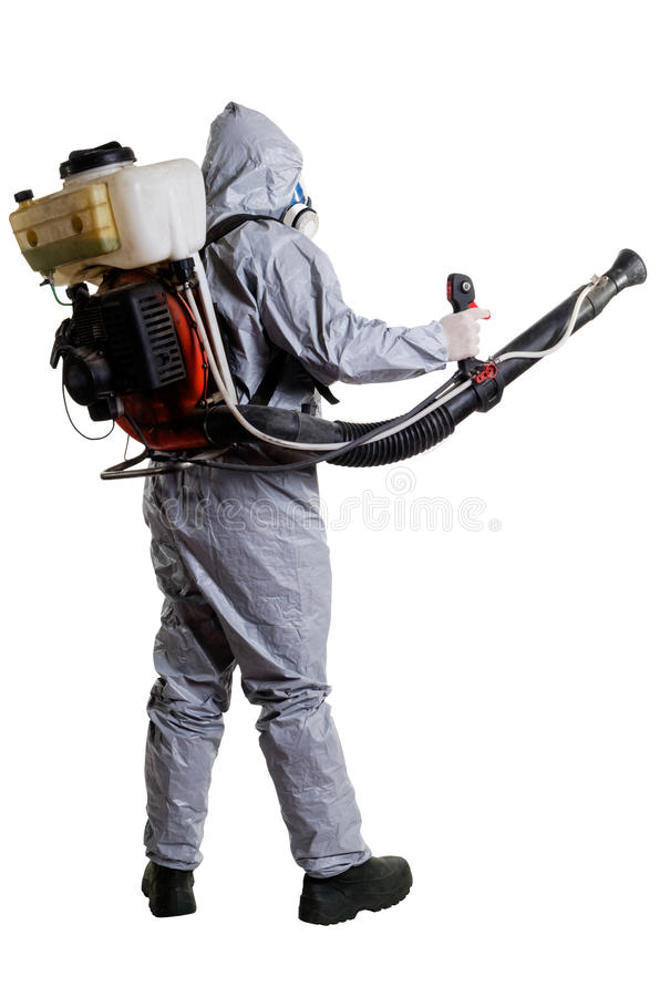 PEST CONTROL WORKER. A pest control worker wearing a mask, hood, protective suit and dual air filters holding a hose to help exterminate rats and other vermin royalty free stock photo