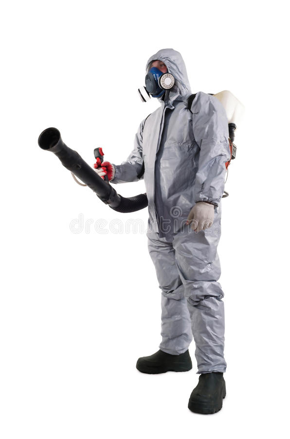 A pest control worker. Wearing a mask, hood, protective suit and dual air filters holding a hose to help exterminate rats and other vermin royalty free stock photo