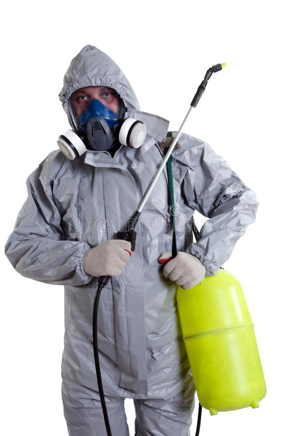 A pest control worker. Wearing a mask, hood, protective suit and dual air filters holding a hose to help exterminate rats and other vermin stock photos
