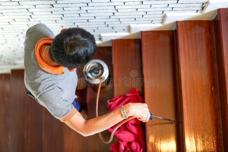 Pest / termites control services on wood stair in the new house that have termites signs inside it stock photos