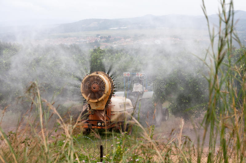 Pesticide aplication. Pesticide spraying machine in the orchard royalty free stock image