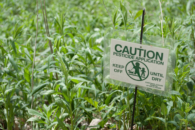 Pesticide sign. Sign warning of recent pesticide application royalty free stock images