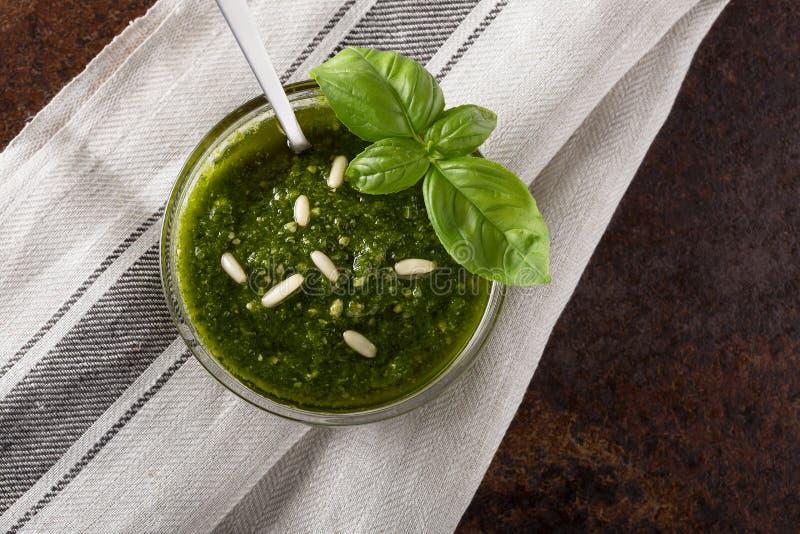 Pesto in a glass bowl with selective focus stock photos