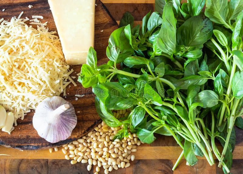 Pesto ingredients on wooden board royalty free stock photo
