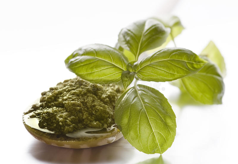 Pesto sauce and fresh basil stock images