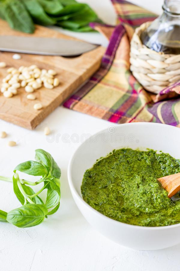 Pesto sauce and ingredients on a white background. Italian cuisine. Vegetarian food. The diet stock images