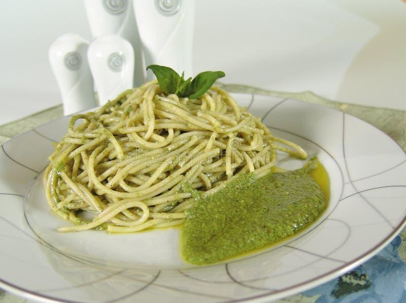 Pesto spaghetti stock images