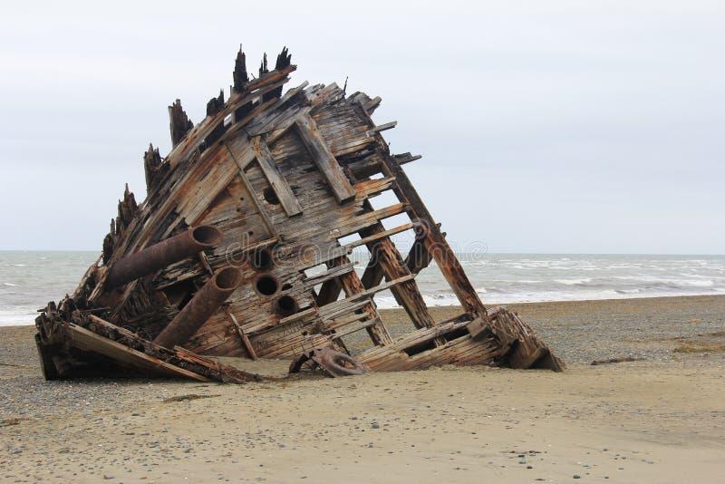 Pesuta ship wreck, Haida Gwaii, BC, Canada. Deteriorating boat marooned in shore in remote area. stock photos
