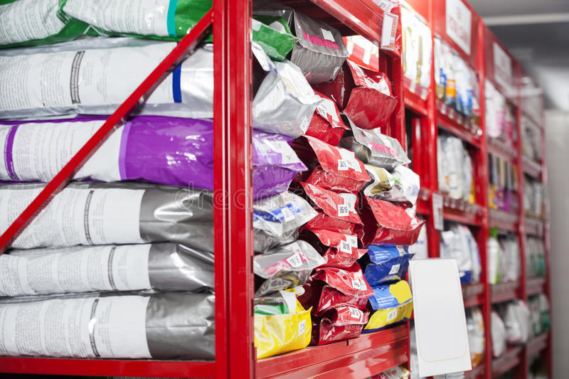 Pet Food Packets At Store. Pet food packets arranged on shelves at store royalty free stock image