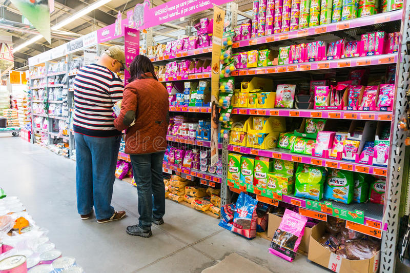 Pet food in store. Customers buying pet food in Hornbach store, Romania stock photos