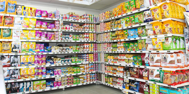 Pet food store. Shelving. Shelf unit. Pet store in a new market opening soon in Rome Italy royalty free stock photos
