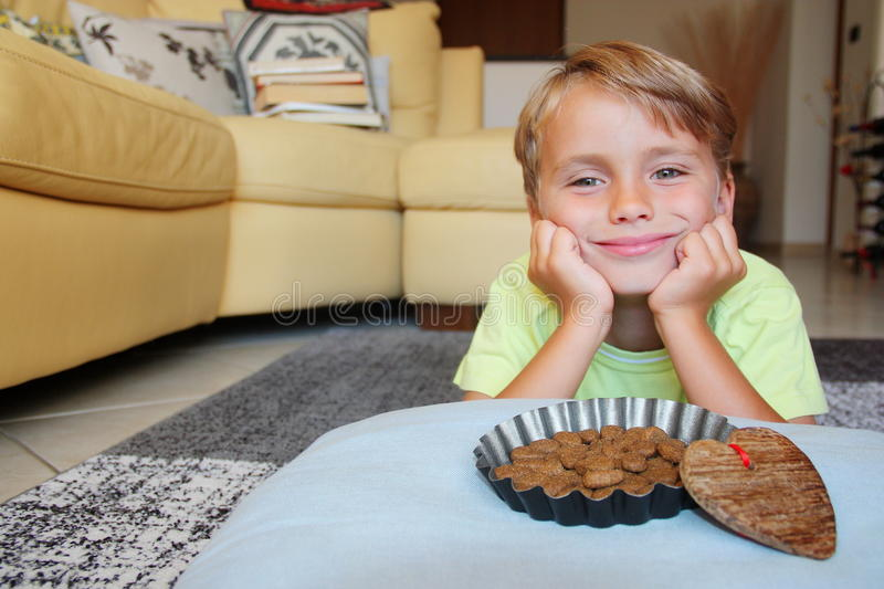 Pet perspective: join a smiling thoughtful kid with a food bowl.  royalty free stock photo