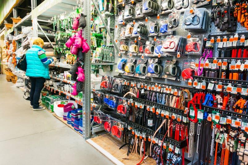 Pet store accessories. Customer in pet store accessories department, Hornbach hypermarket, Romania stock photos