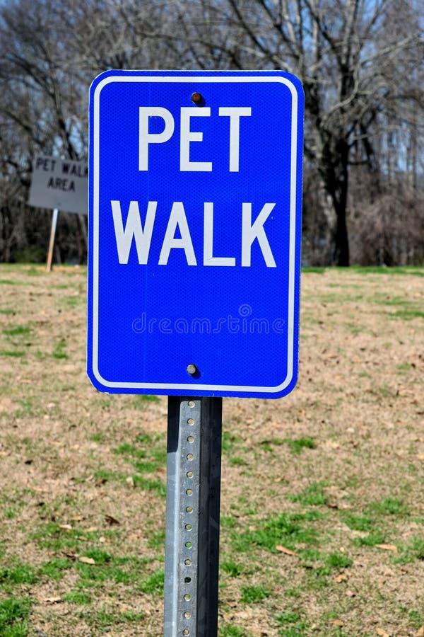Pet walk sign. A pet walk sign at a rest stop area stock photography