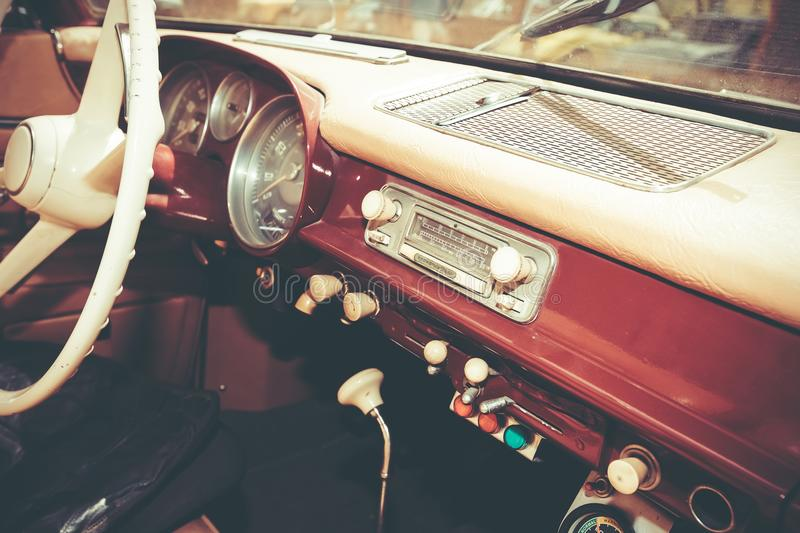 PETAH TIQWA, ISRAEL - MAY 14, 2016: Steering wheel and dashboard in interior of old retro automobile in Petah Tiqwa, Israel. PETAH TIQWA, ISRAEL - MAY 14, 2016 stock photos