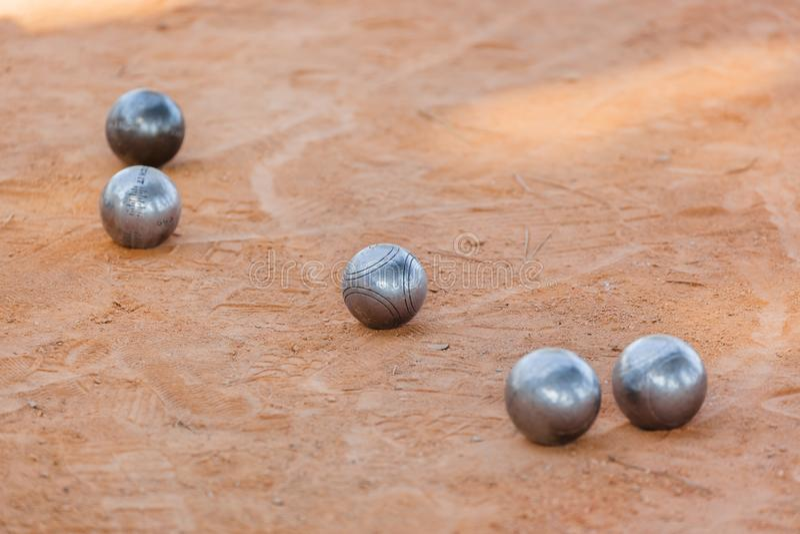 Petanque balls on the ground. Sport background stock photos