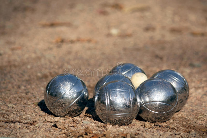 Petanque balls with a jack (cochonnet) royalty free stock images