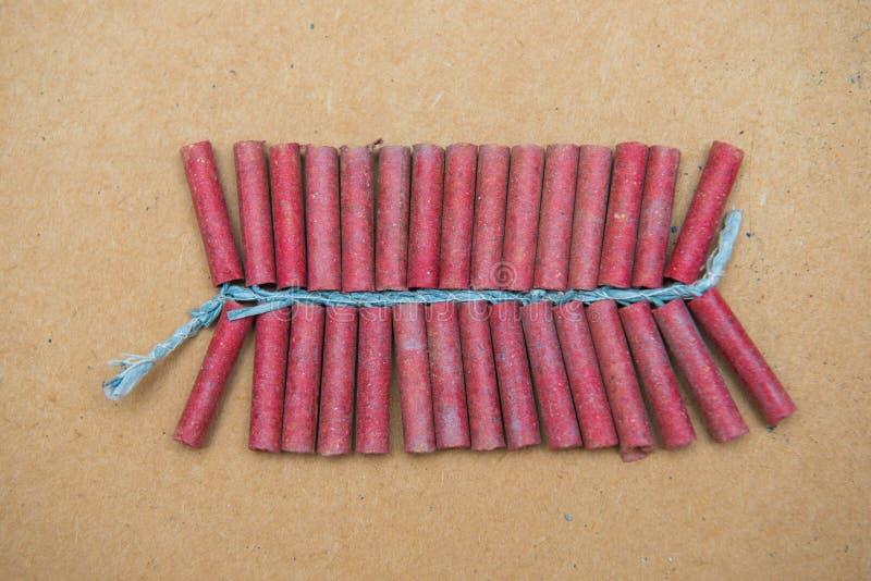 Petardos rojos en fondo marrón imagen de archivo libre de regalías