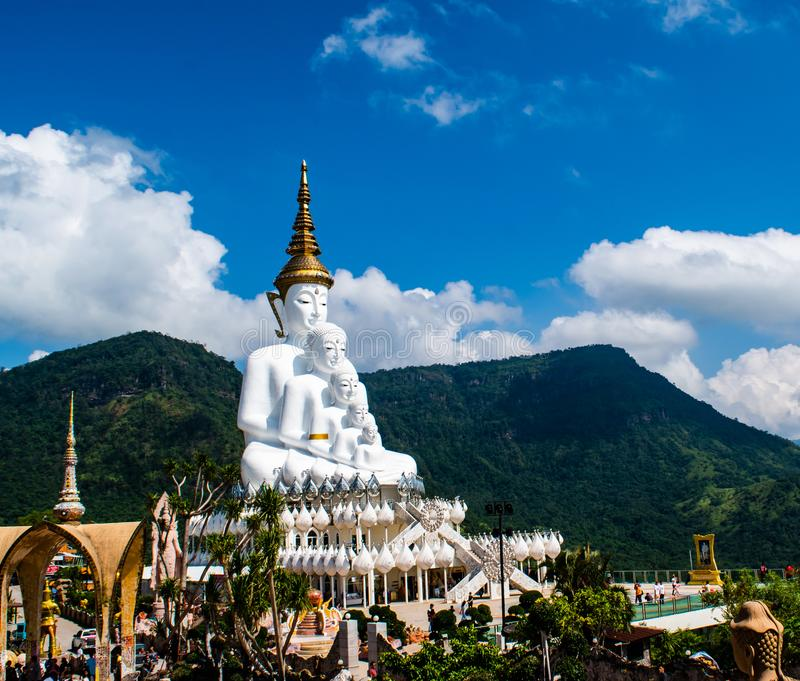 Petchabun , Thailand , August 8, 2019 : White five Buddha at Wat Pha son Kaew beautiful landmark at Petchabun , Thailand. stock image