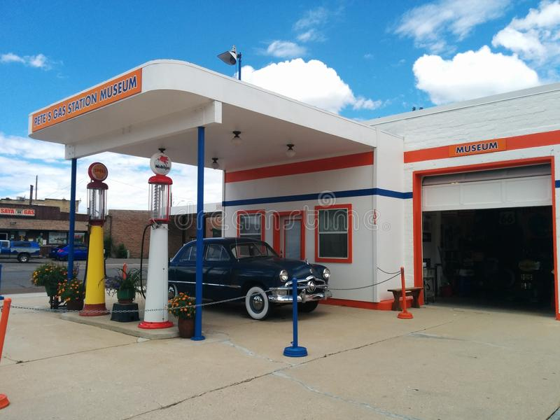 Pete`s Gas Station Museum in Williams, Arizona. With a dark blue Hudson Hornet parked in front and gas pumps stock photos