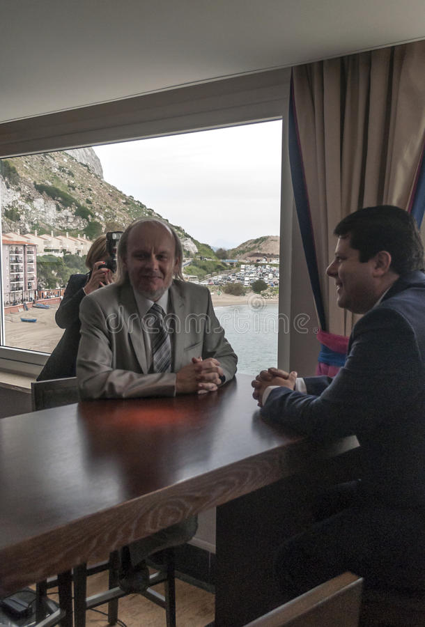 Peter Caruana. Prime Minister Peter Caruana of Gibraltar with Stuart Conquest director of the Gibraltar chess tournament. It is an image vertical beach cove at stock photo