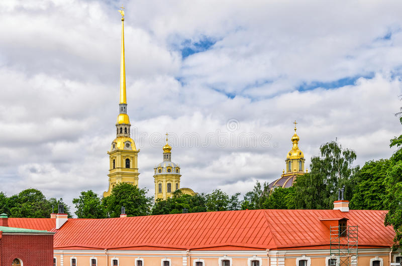 Peter and Paul fortress, the domes of Peter and Paul cathedral and the roof of the Ingenerny Engineering house. stock images