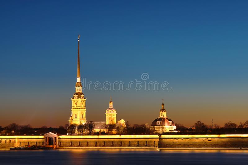 Peter and Paul Fortress of St. Petersburg, Russia in the rays of setting sun. royalty free stock images