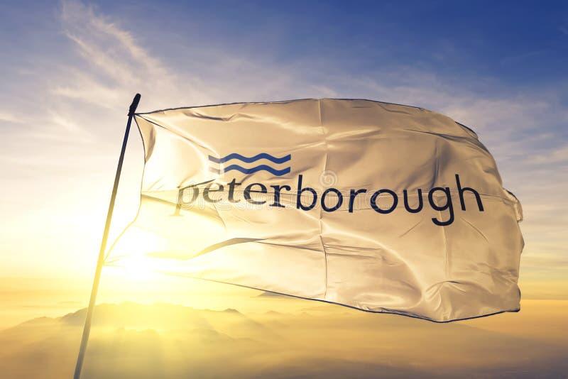 Peterborough of Ontario of Canada flag waving on the top sunrise mist fog. Peterborough of Ontario of Canada flag textile cloth fabric waving on the top sunrise stock photos