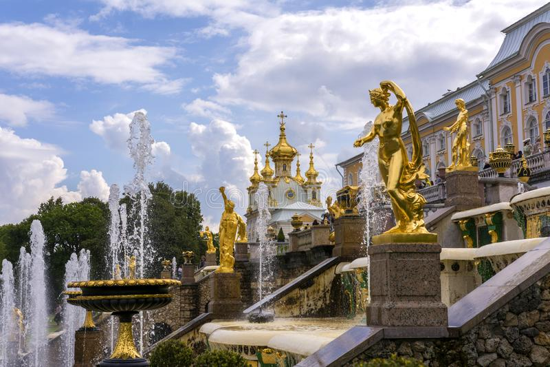 Peterhof, Russia, 08 aug 2019. Golden statues and fountains in the Palace complex.  royalty free stock photography