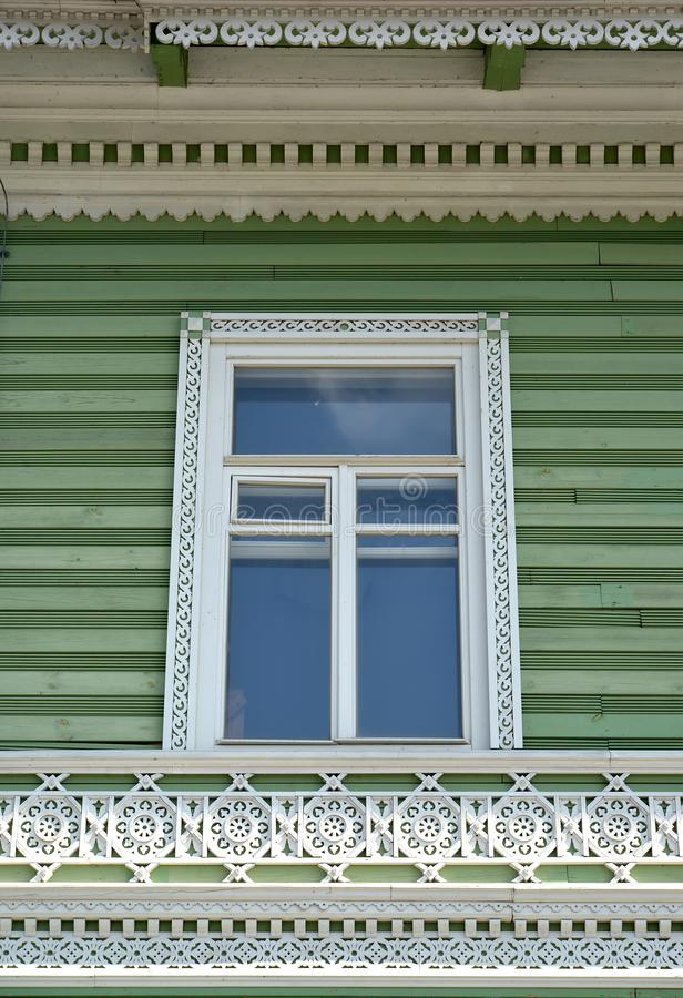 PETERHOF, RUSSIA. Wooden carved platband and decor of a facade of the building of the former estate of I.A. Khrushchev 1870-1889 stock photos