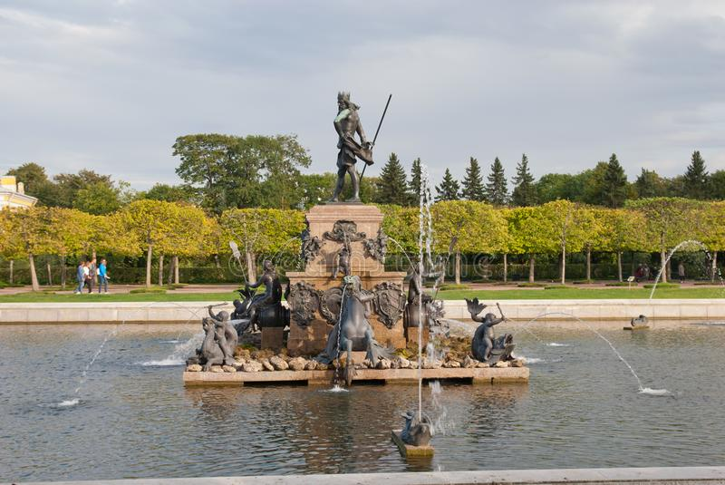People near Neptune Fountain in The State Museum Preserve Peterhof. Russia stock photos