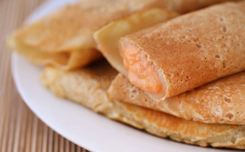 Petiscos deliciosos do bengali nomeados como Patishapta foto de stock