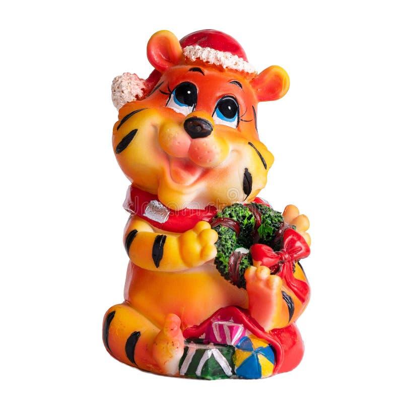 Petit animal de tigre orange de statuette de jouet de Noël petit dans un chapeau photo stock
