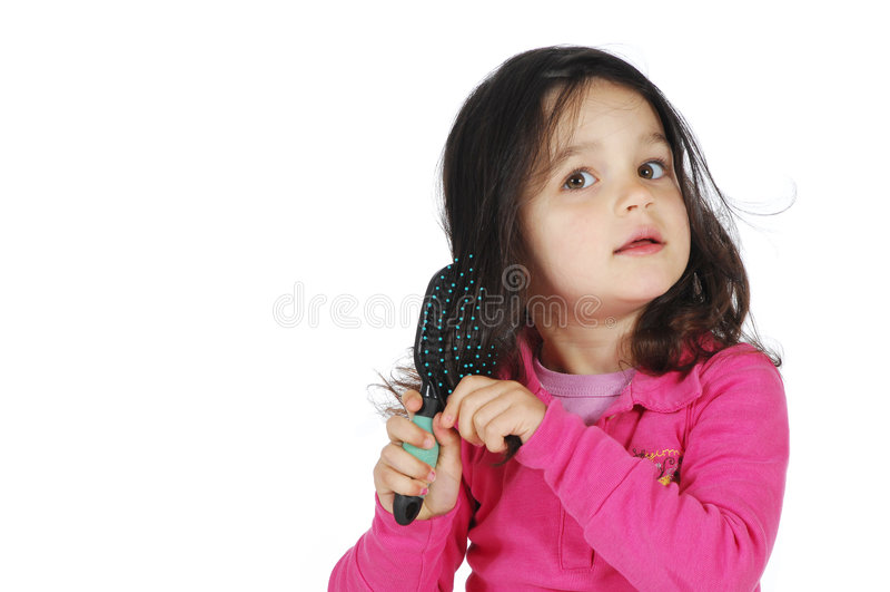 Petit balai mignon de fille le cheveu photographie stock