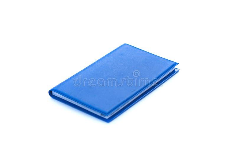 petit Bloc-notes bleu isolé sur fond blanc photos libres de droits