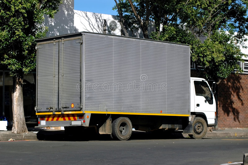 Petit camion de distribution photographie stock