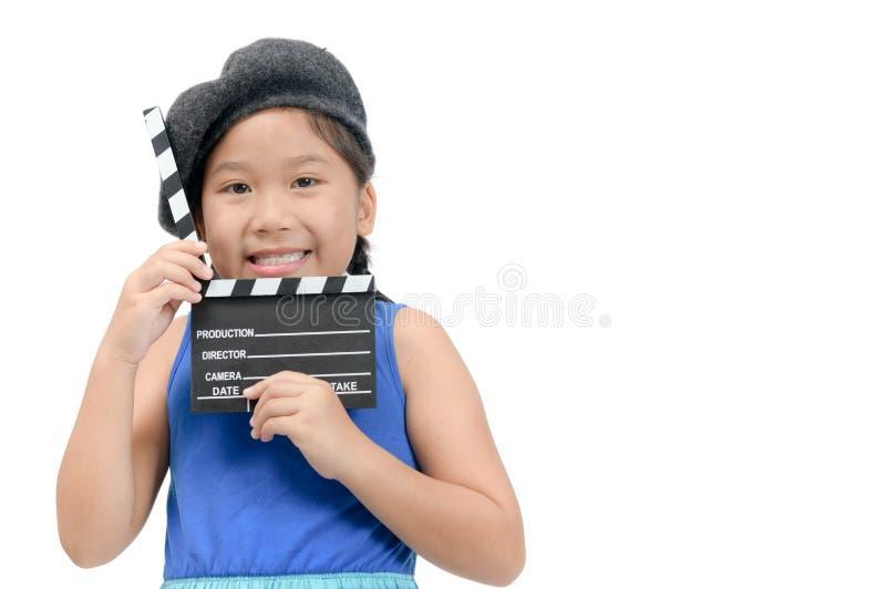 Petit directeur tenant le panneau de clapet ou le film d'ardoise photos libres de droits